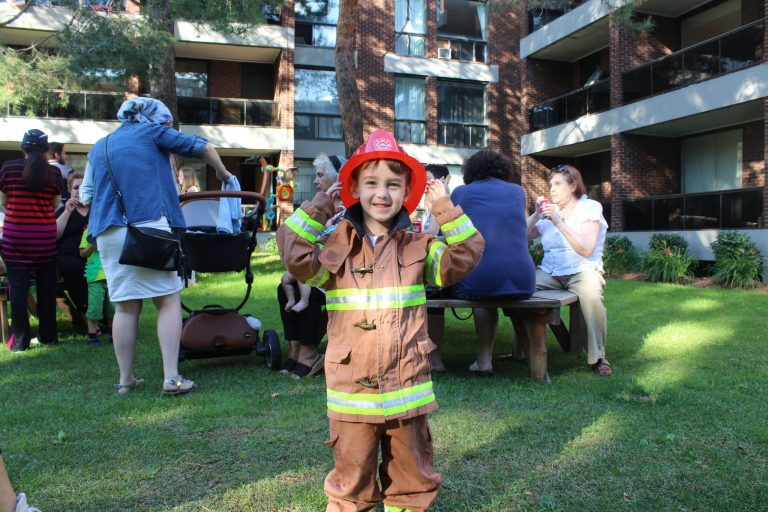 Boy wearing firefighter suit